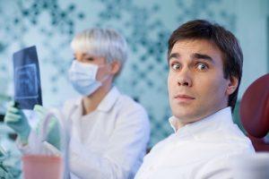 Scared man in dental office